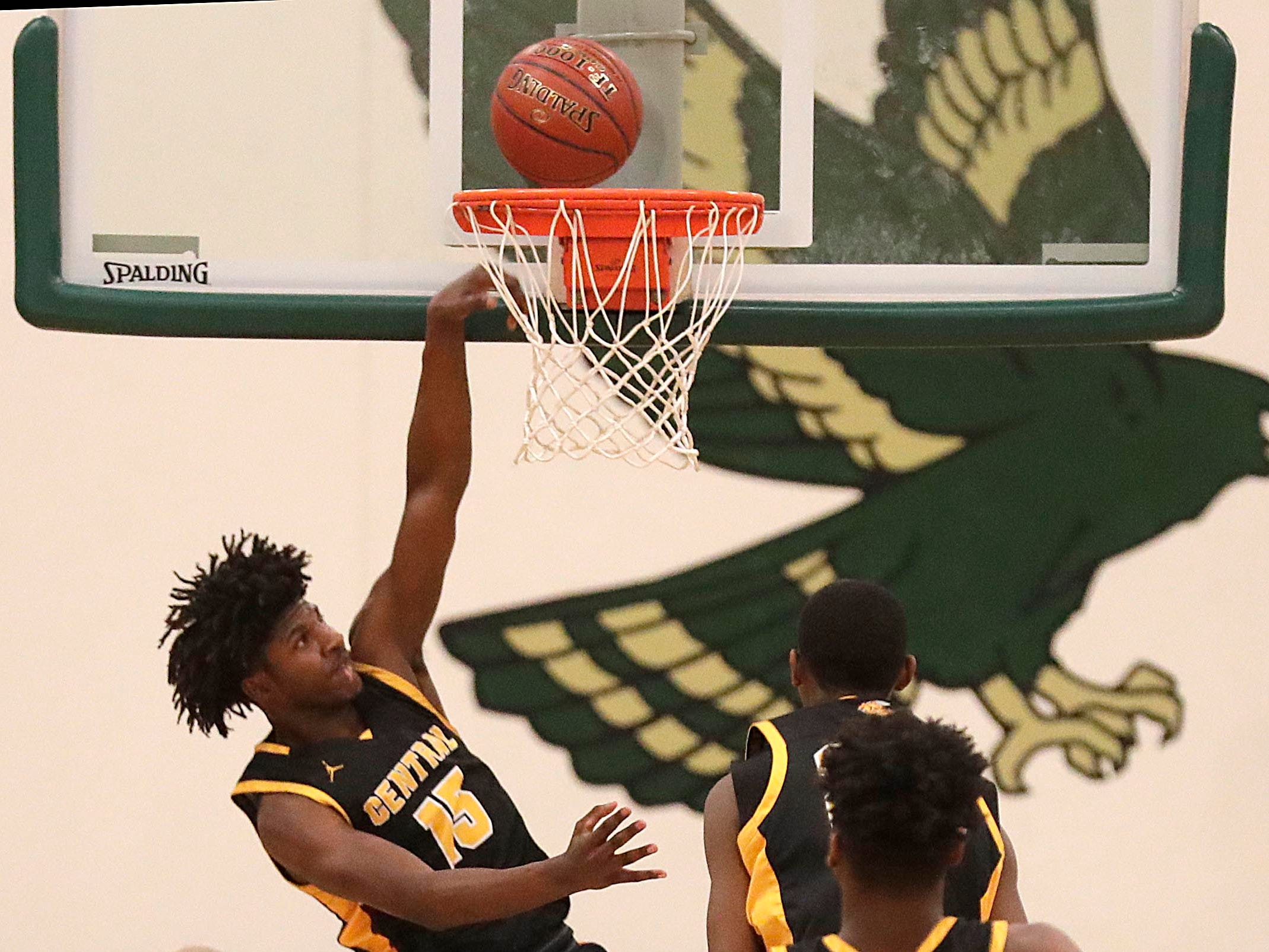 Shilo Bowles of West Allis Central dunks during  the Woodland Conference boys basketball championship game at Greenfield on Wednesday, Feb. 20, 2019.