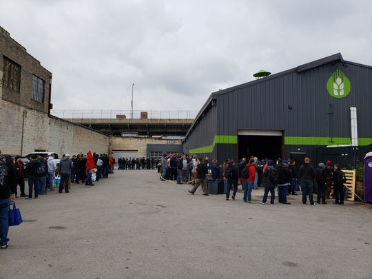 People wait in line at Third Space Brewing Co. on Oct. 27, 2018, for the release of Haunted Barrel, a candy bar porter.