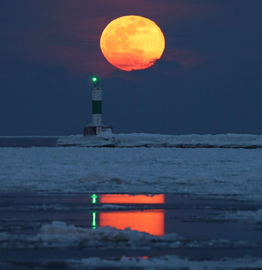 A full moon rises over Lake Michigan near the Summerfest grounds in Milwaukee on Tuesday, Feb. 19, 2019.