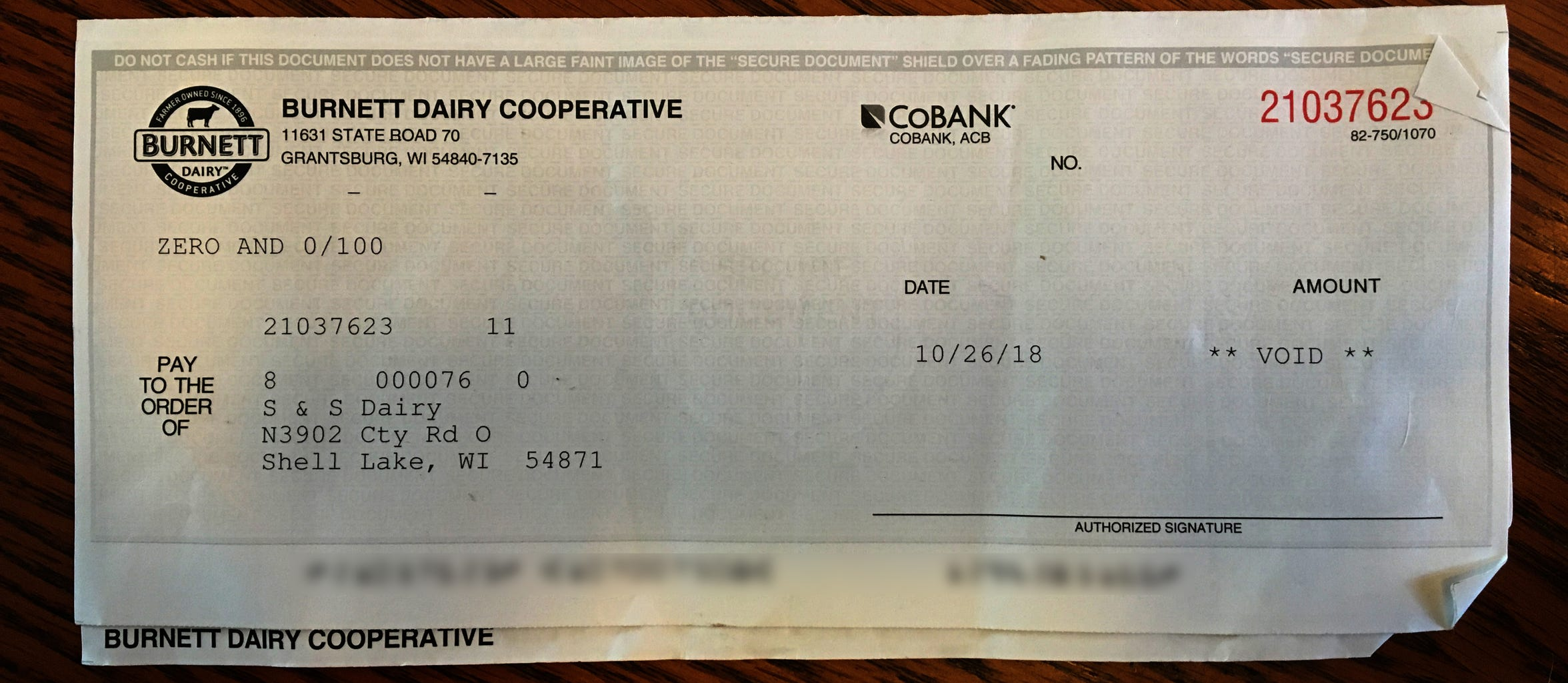 A check from the dairy cooperative is shown voided because the bank has first dibs on money from the milk sold by S & S Dairy.