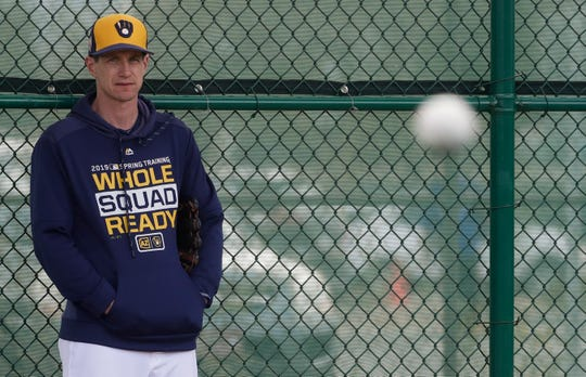 Brewers manager Craig Counsell watches a spring training workout on Feb. 17 in Phoenix.