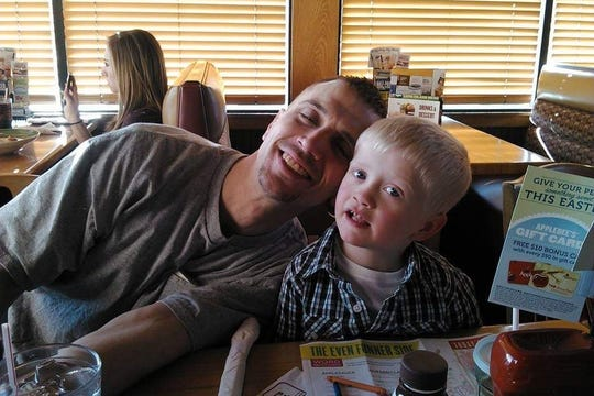 Kevin Duffy Sr. cuddles with his son Konner in this undated photo. Kevin, along with his two oldest children, was killed in a Feb. 19 fire at their town of Waukesha home. Only Konner survived the fire, thanks to the efforts of his father.