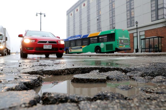 A pothole on North 6th Street near the corner of West Michigan Street in Milwaukee.