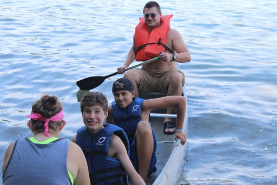 Boating is a good activity for kids with heart disease because they can choose whether to paddle or just relax in the boat.