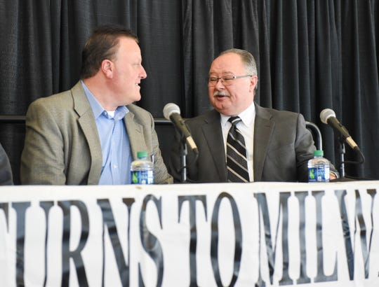 Promoter Bob Sargent (left) and Wisconsin State Fair Park board chairman John Yingling converse before a news conference Thursday at the Expo Center regarding the return of racing to the Milwaukee Mile.