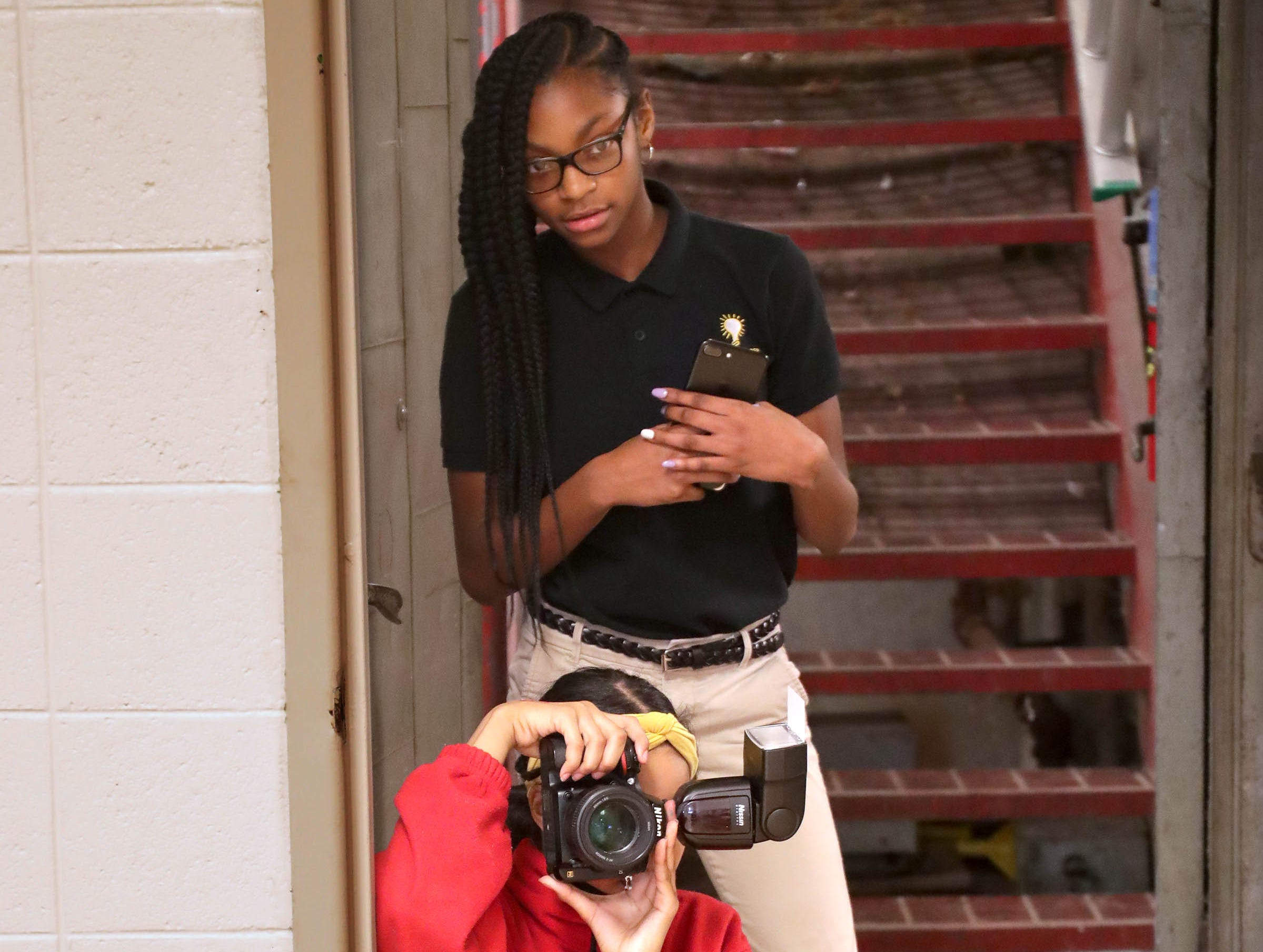 Ryanne Rosemond, a  Milwaukee College Prep sixth-grader, takes photos as fellow student Makynzie Russ looks on.