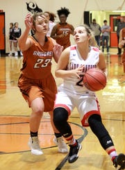 Norfork's Whitlee Layne drives to the basket during the Lady Panthers' victory over Armorel on Wednesday night.