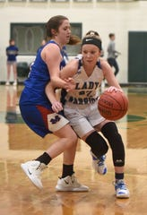 Cotter's Kaylee Crownover drives to the basket against Mountainburg on Wednesday night.
