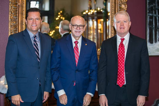 Mountain Home's Lang Zimmerman (far right) is pictured with Joe Steinmetz (center), chancellor of the University of Arkansas, and Mark Power, vice chancellor for university advancement. Zimmerman has joined the University of Arkansas College of Engineering Dean's Advisory Council, a news release from the university reports.