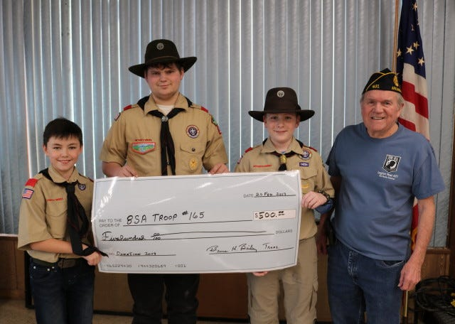 The Bull ShoalsAmerican Legion Post 431 recently donated $500 to theBoy Scouts of America Troop 165. Pictured are: (from left)Evan Franklin, Blayne Hinson, Charlie Bailey of Troop 165 and Sammy Davis, Jr. of the American Legion.