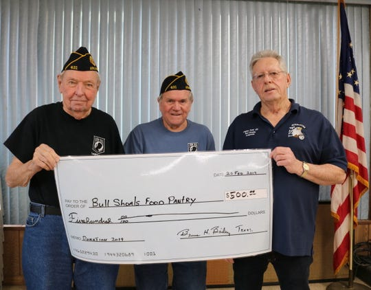 The Bull Shoals American Legion Post 431 recently donated $500 to the Bull Shoals Food Pantry. Pictured are: Bruce Bailey of the American Legion, accepting on behalf of the Food Pantry; Sammy Davis Jr., American Legion member; and Ron Barnes, American Legion member.