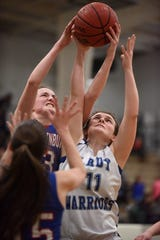 Cotter's Hailey Cunningham battles for a rebound on Wednesday night.