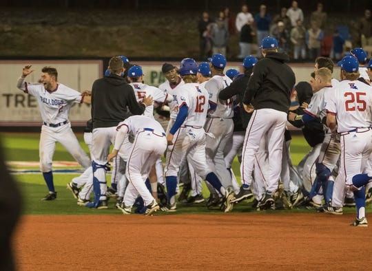 Louisiana Tech's baseball team swarms the field after Mason Robinson's (3) walk-off double to win the game against University of Louisiana at Lafayette 3-2 at Pat Patterson Park in Ruston, La. on Feb. 20.