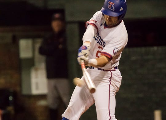 Louisiana Tech's Parker Bates (2) makes contact with the ball during the game against University of Louisiana at Lafayette at Pat Patterson Park in Ruston, La. on Feb. 20.