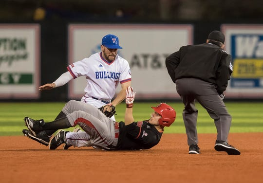 Louisiana Tech's Hunter Wells (9) tags out University of Louisiana at Lafayette's Hunter Kasuls (19) at second base during the game at Pat Patterson Park in Ruston, La. on Feb. 20.