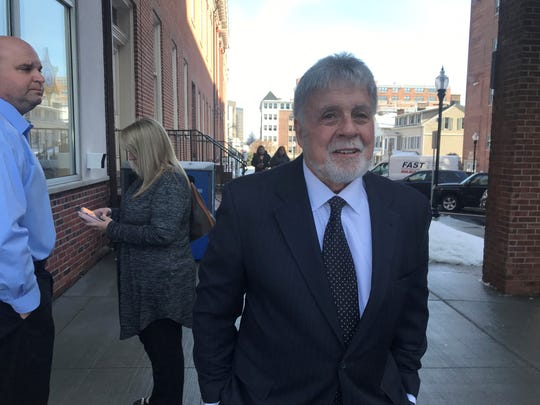 Former attorney Richard 'Richie' Roberts, whose exploits as a narcotics detective were depicted by Russell Crowe in the film 'American Gangster,'  arrives at Morristown Superior Court Thursday, Feb. 21, 2019, to face fraud and conspiracy charges. He received a trial date of April 1. Another attorney charged in the case pleaded guilty.