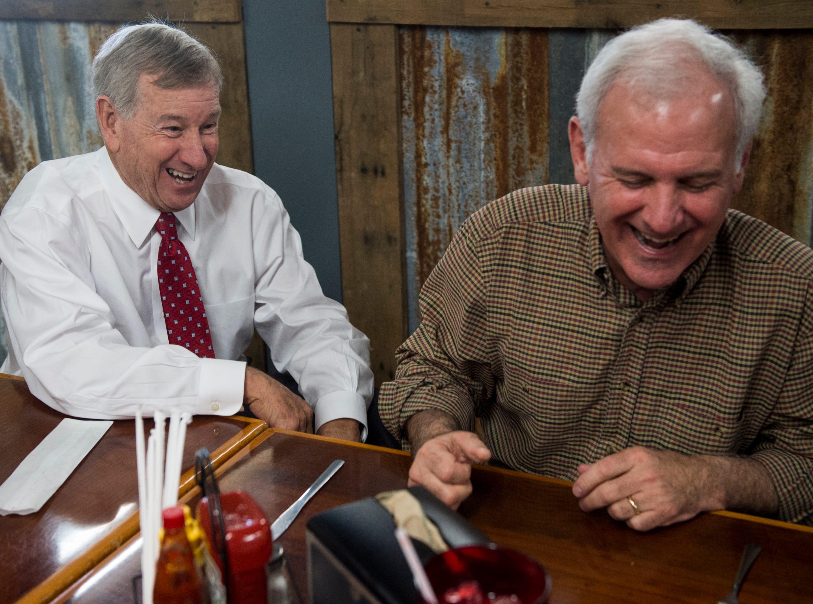Mayor Todd Strange and U.S. Rep. Bradley Byrne joke around at Yellowhammer Cafe in Montgomery, Ala., on Thursday, Feb. 21, 2019.