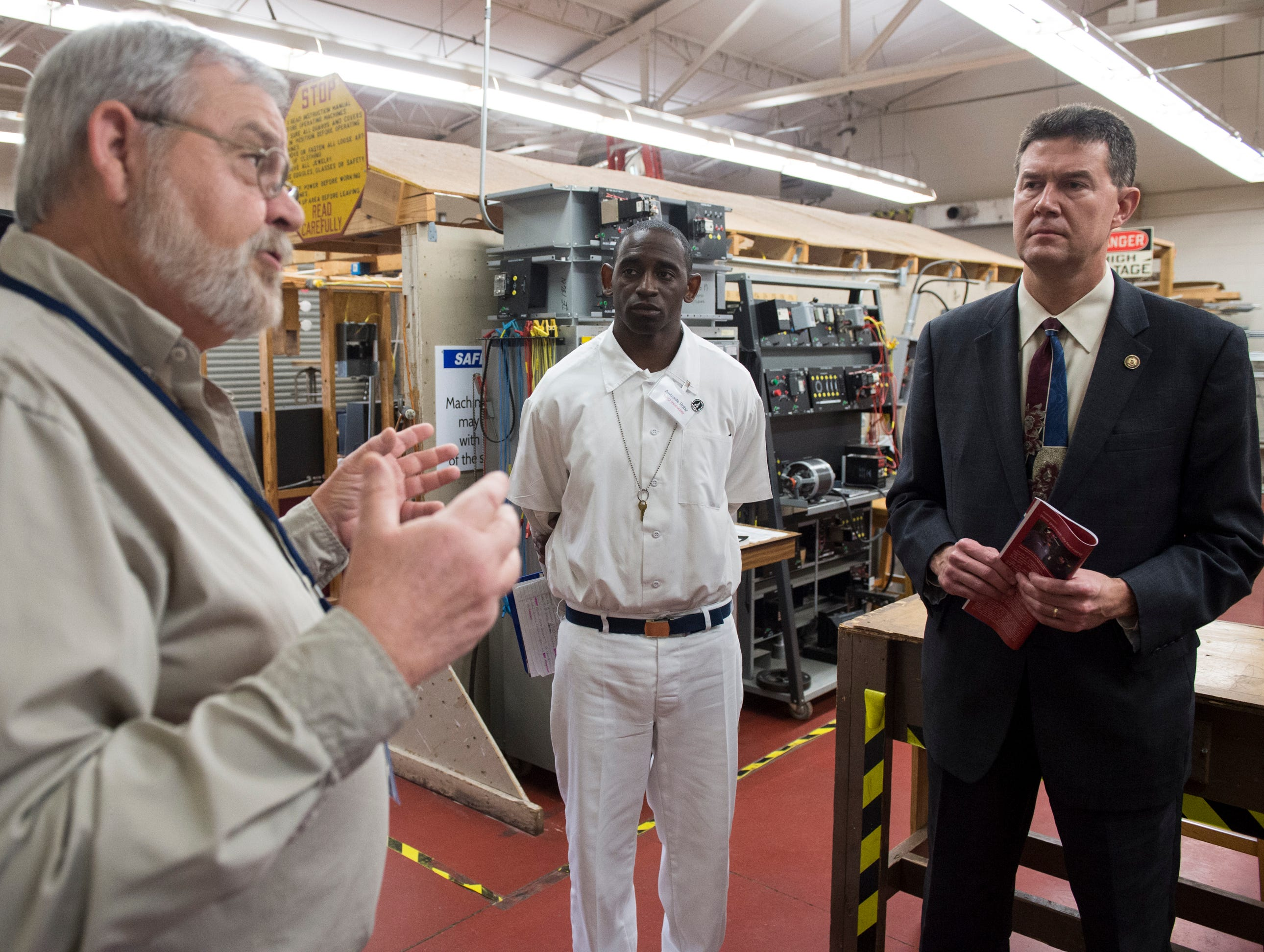 Instructor Donald Huskey, left, speaks to Alabama Secretary of State John Merrill during a tour at the Ingram State Technical College Draper instructional service center in Elmore, Ala., on Thursday, Feb. 21, 2019.