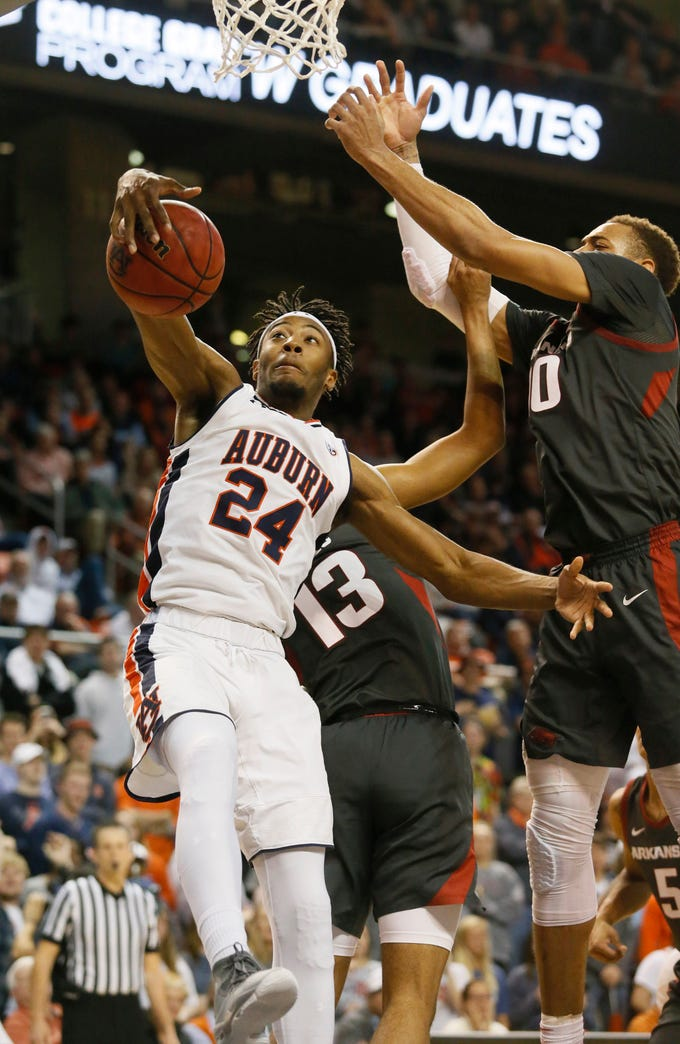 Feb 20, 2019; Auburn, AL, USA; Auburn Tigers forward Anfernee McLemore (24) grabs a rebound against the Arkansas Razorbacks during the second half at Auburn Arena. Mandatory Credit: John Reed-USA TODAY Sports