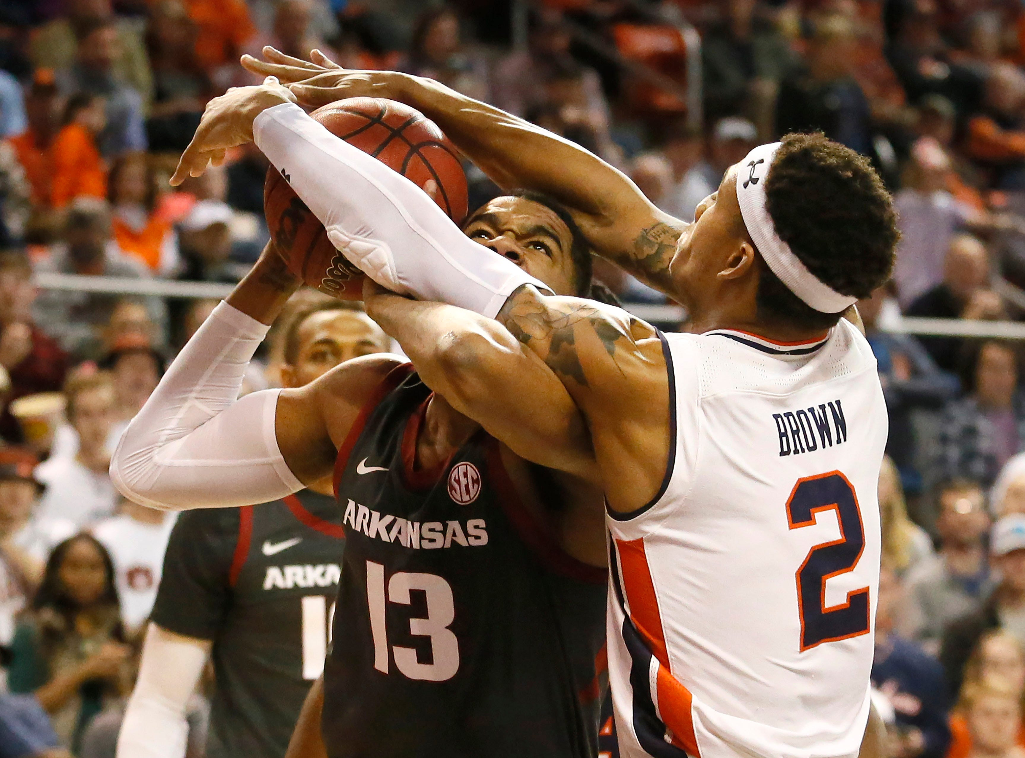Feb 20, 2019; Auburn, AL, USA; Auburn Tigers guard Bryce Brown (2) fouls Arkansas Razorbacks guard Mason Jones (13) during the first half at Auburn Arena. Mandatory Credit: John Reed-USA TODAY Sports