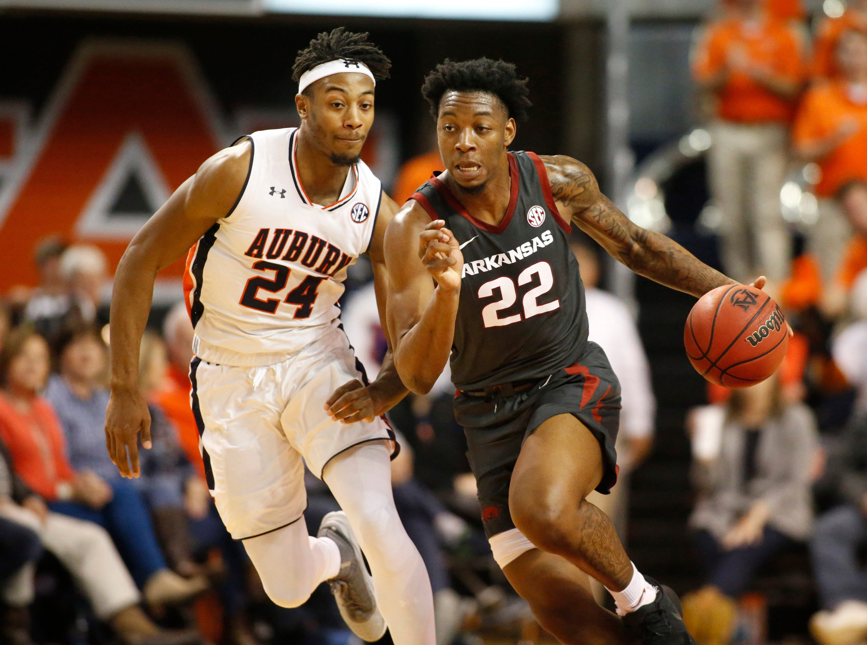 Feb 20, 2019; Auburn, AL, USA; Arkansas Razorbacks forward Gabe Osabuonien (22) moves up the court against Auburn Tigers forward Anfernee McLemore (24) during the first half at Auburn Arena. Mandatory Credit: John Reed-USA TODAY Sports