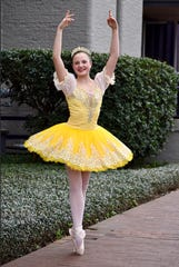 "Savannah Golden, 17, of Millbrook dances the role of Beauty in Alabama Dance Theatre's ""Beauty & the Beast."""