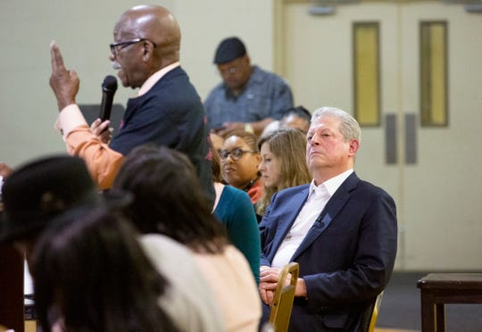 Former Vice President Al Gore looks on as Birmingham resident, Jimmy Smith, talks about environmental injustices in his neighborhood.