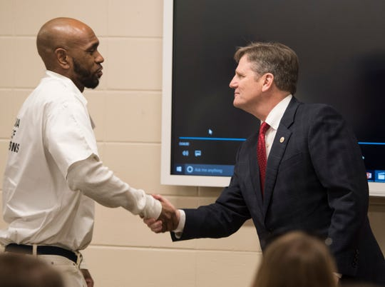 Student-inmate James Morgan, left, is introduced by Department of Corrections commissioner Jeff Dunn at the Ingram State Technical College Draper instructional service center in Elmore, Ala., on Thursday, Feb. 21, 2019.