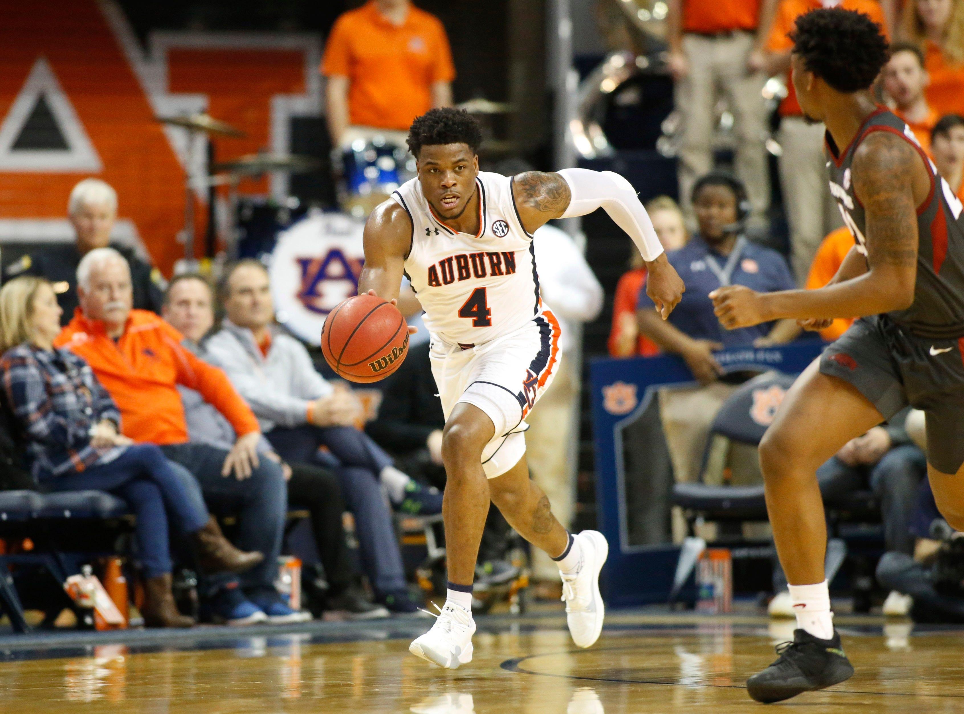 Feb 20, 2019; Auburn, AL, USA; Auburn Tigers forward Malik Dunbar (4) runs a play against the Arkansas Razorbacks during the second half at Auburn Arena. Mandatory Credit: John Reed-USA TODAY Sports