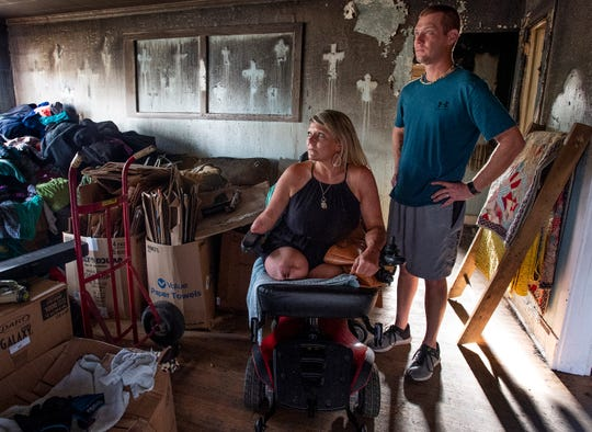 Jessica Crumpton West, who is a triple amputee, and her husband Justin West are gathering what is left of their belongings at their home in Montgomery, Ala., on Thursday February 21, 2019. The house was damaged by fire.
