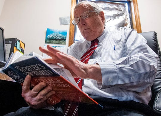 Goodloe Sutton, publisher of the Democrat-Reporter newspaper, uses a dictionary to look up the words lynch and mob as he discusses the media coverage of his controversial editorial at the newspaper office in Linden, Ala., on Thursday February 21, 2019.