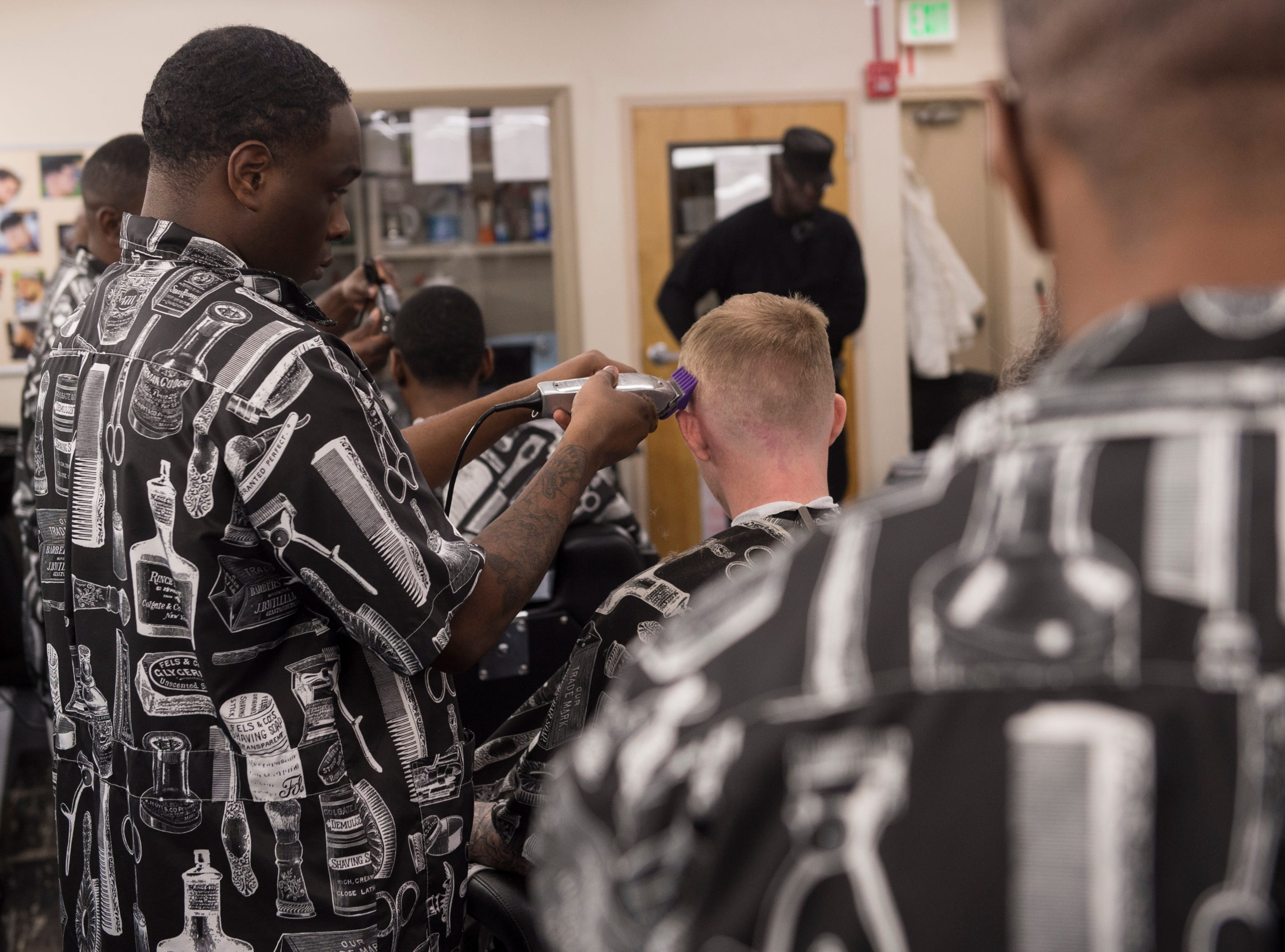 Barber student-inmates work on projects at the Ingram State Technical College Draper instructional service center in Elmore, Ala., on Thursday, Feb. 21, 2019.