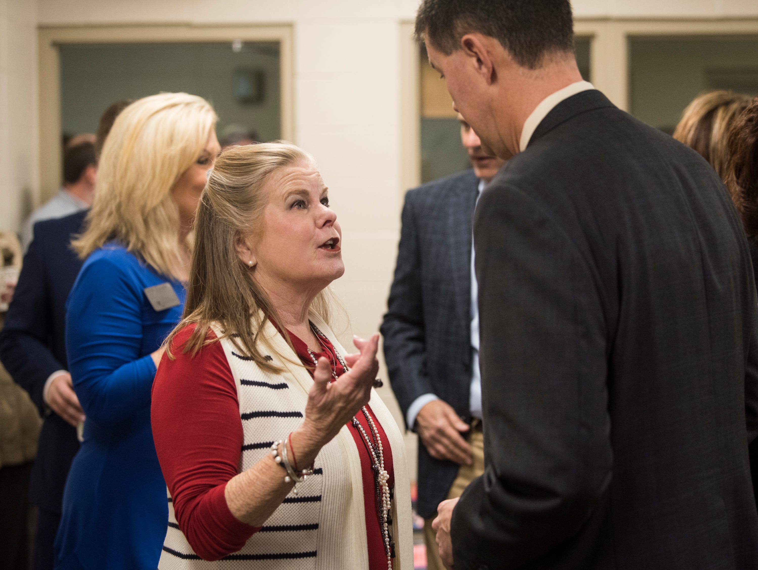 Former Alabama Supreme Court justice Sue Cobb speaks with Alabama Secretary of State John Merrill at the Ingram State Technical College Draper instructional service center in Elmore, Ala., on Thursday, Feb. 21, 2019.