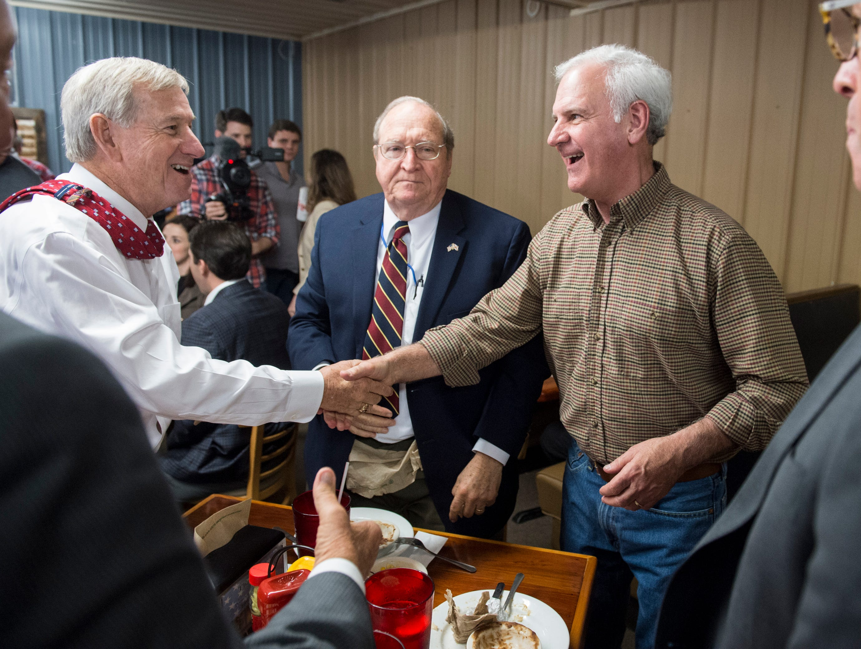 Montgomery Mayor Todd Strange shakes hands with U.S. Rep. Bradley Byrne at Yellowhammer Cafe in Montgomery, Ala., on Thursday, Feb. 21, 2019.