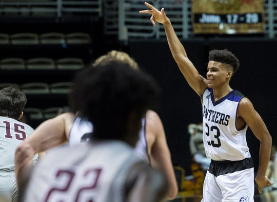 Prattville Christian's BJ Comer (23) celebrates after making a three pointer during the Class 3A southwest regional championship at Dunn-Oliver Acadome in Montgomery, Ala., on Wednesday, Feb. 20, 2019. Prattville Christian defeated Thomasville 70-33.