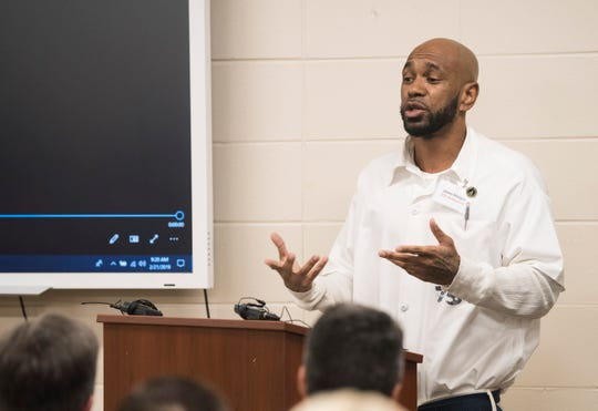 Student-inmate James Morgan speaks to officials at the Ingram State Technical College Draper instructional service center in Elmore, Ala., on Thursday, Feb. 21, 2019.