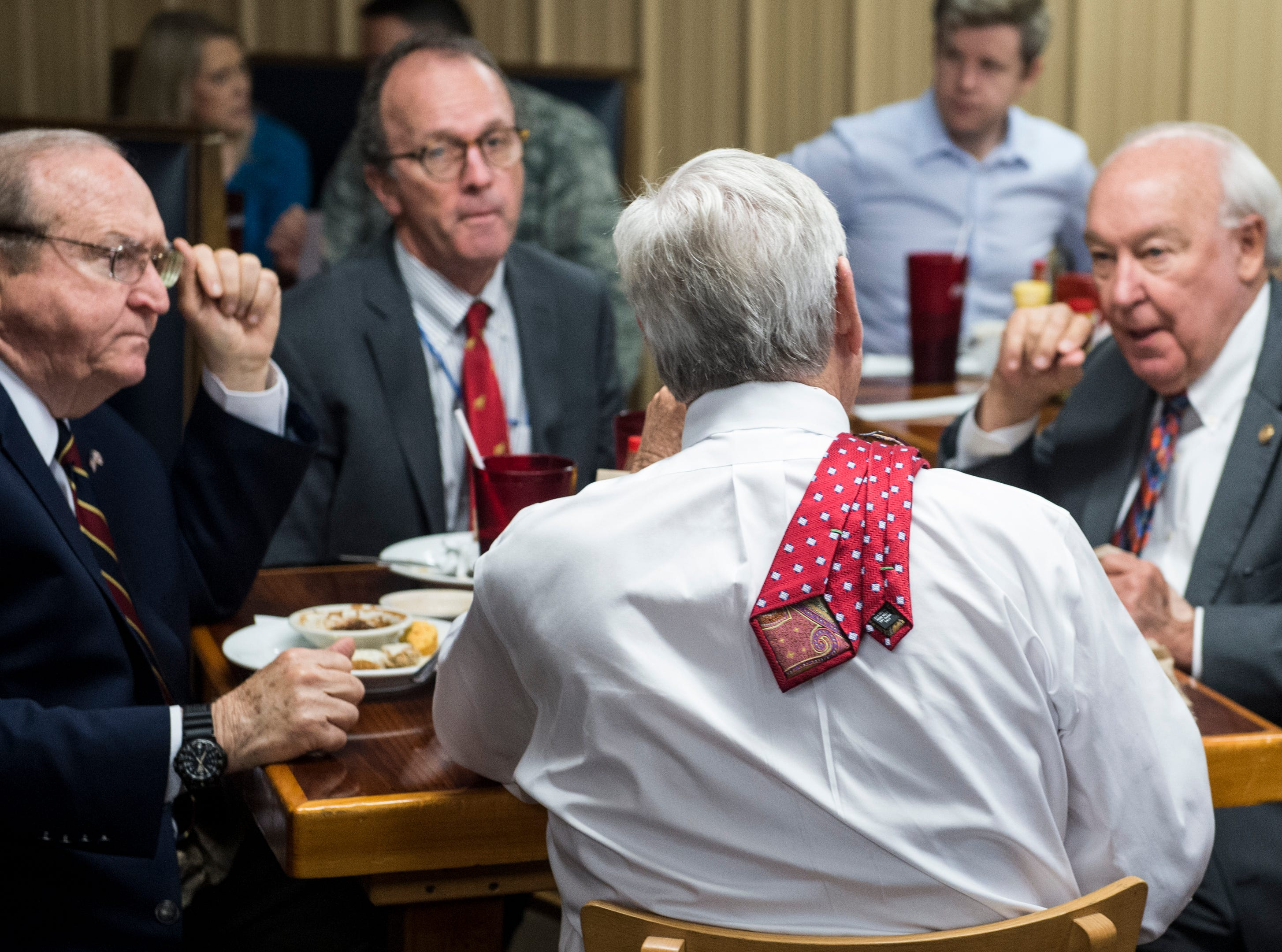 Montgomery Mayor Todd Strange, middle, enjoys a meat and three meal as he waits for U.S. Rep. Bradley Byrne at Yellowhammer Cafe in Montgomery, Ala., on Thursday, Feb. 21, 2019.
