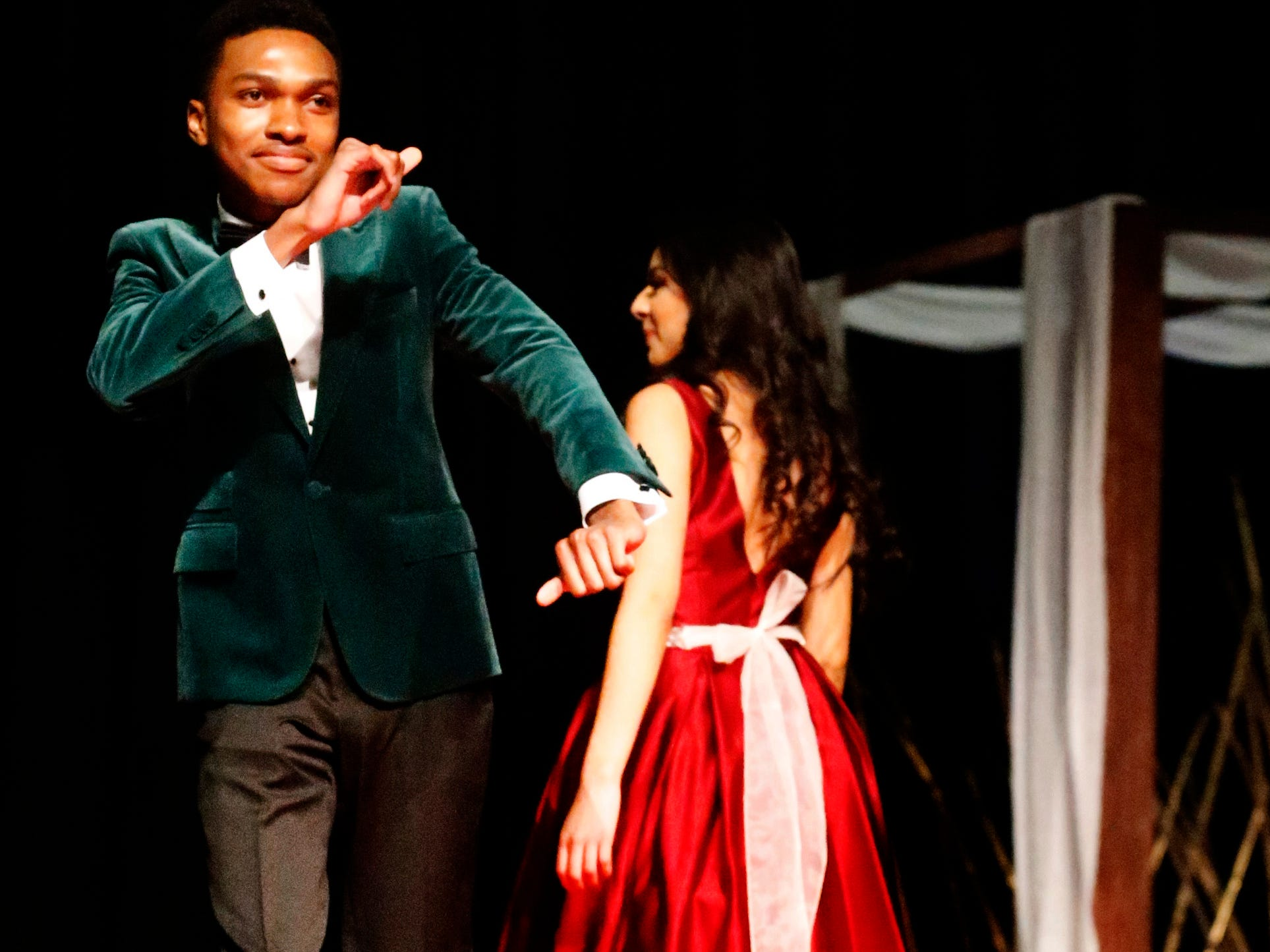 Reggie Stuart dances down to the end of the runway  as Yadira Nieto shows off the back of her dress during the Siegel Prom Fashion show on Thursday, Feb. 14, 2019.