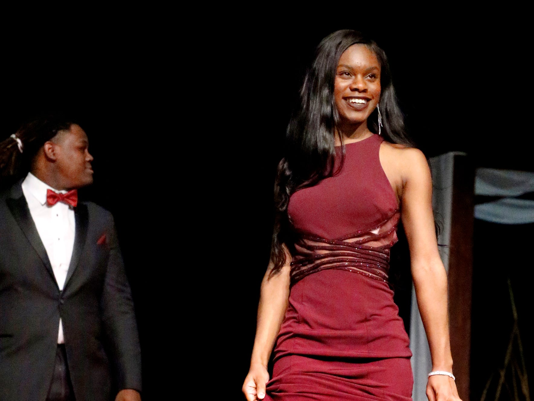 Kimia Wade steps forward to show off her maroon dress as Khalil Wilson waits to show off his tux during the Siegel Prom Fashion show on Thursday, Feb. 14, 2019.