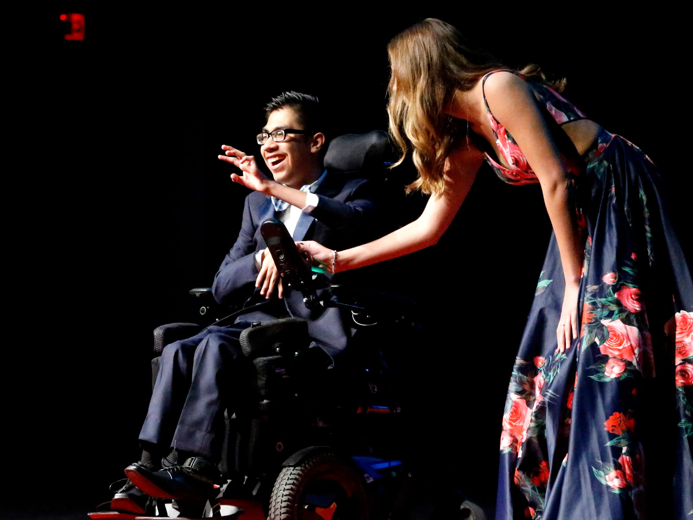 Jason Guerro, left and Ellie Hooper, right show off the latest in prom fashions during the Siegel Prom Fashion show on Thursday, Feb. 14, 2019.
