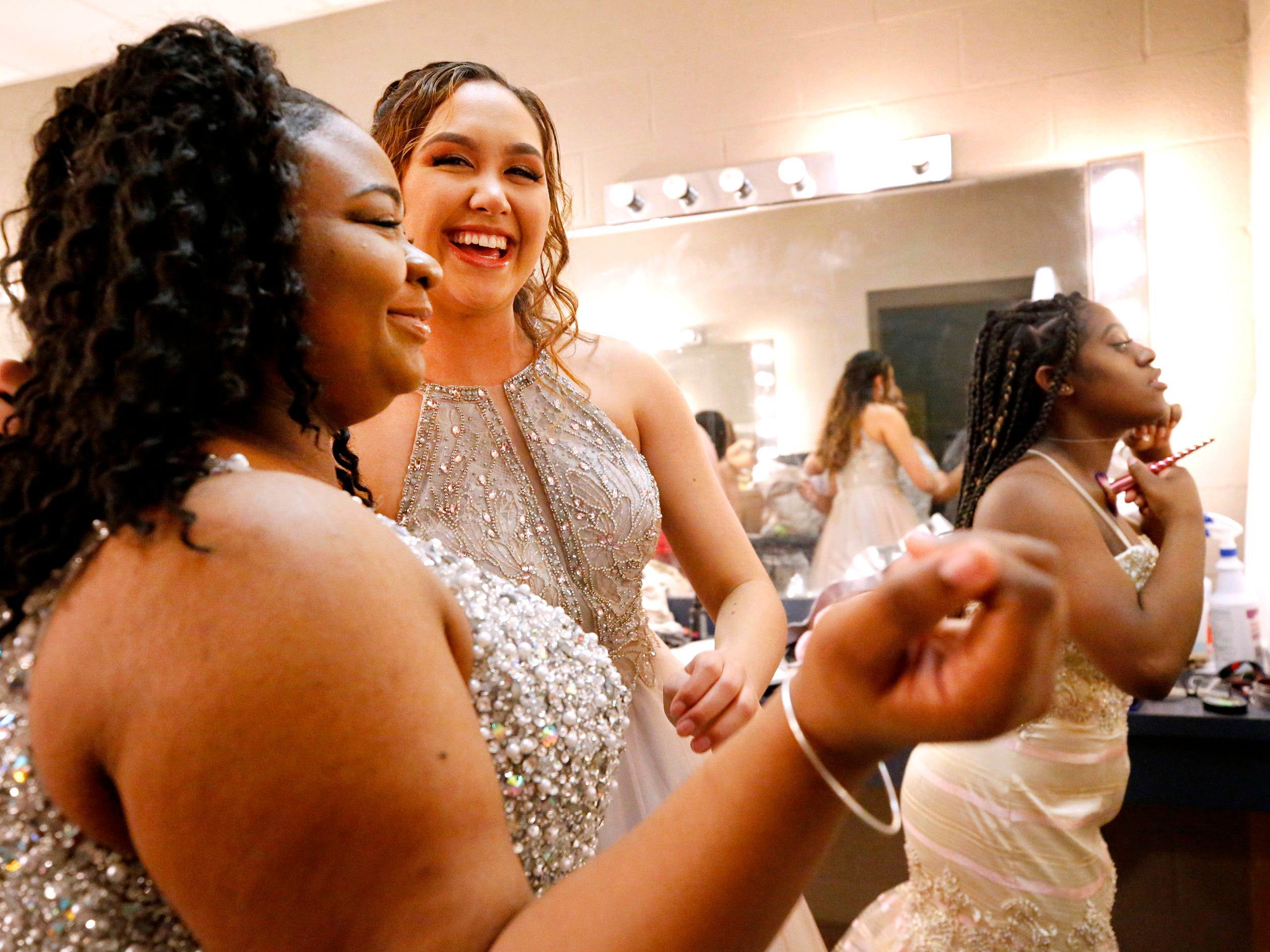 Shkayla Davis, left, Jasmine Huntsman, center and Amia Brewster, right all get ready for the Siegel Prom Fashion show on Thursday, Feb. 14, 2019.