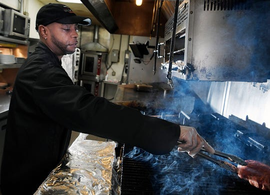 Grill master Choya Phillips been recognized for grilling 1 million steaks in his 28 years at the same LongHorn Steakhouse in Madison. Phillips  cooks a steak at Longhorn Steaks in Madison on Wednesday, Feb. 20, 2019.