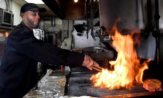 Choya Phillips has grilled 1 million steaks in his 28 years at the same LongHorn Steakhouse in Madison. Phillips  cooks a steak at Longhorn Steaks in Madison on Wednesday, Feb. 20, 2019.