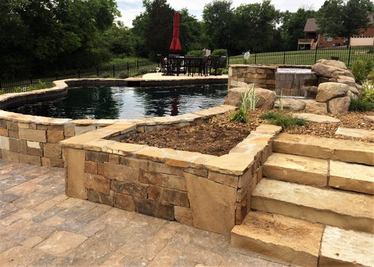 Amber Hurdle's outdoor space includes a kitchen, a fireplace, a heated pool and spa and a covered area with infrared heaters in the ceiling.