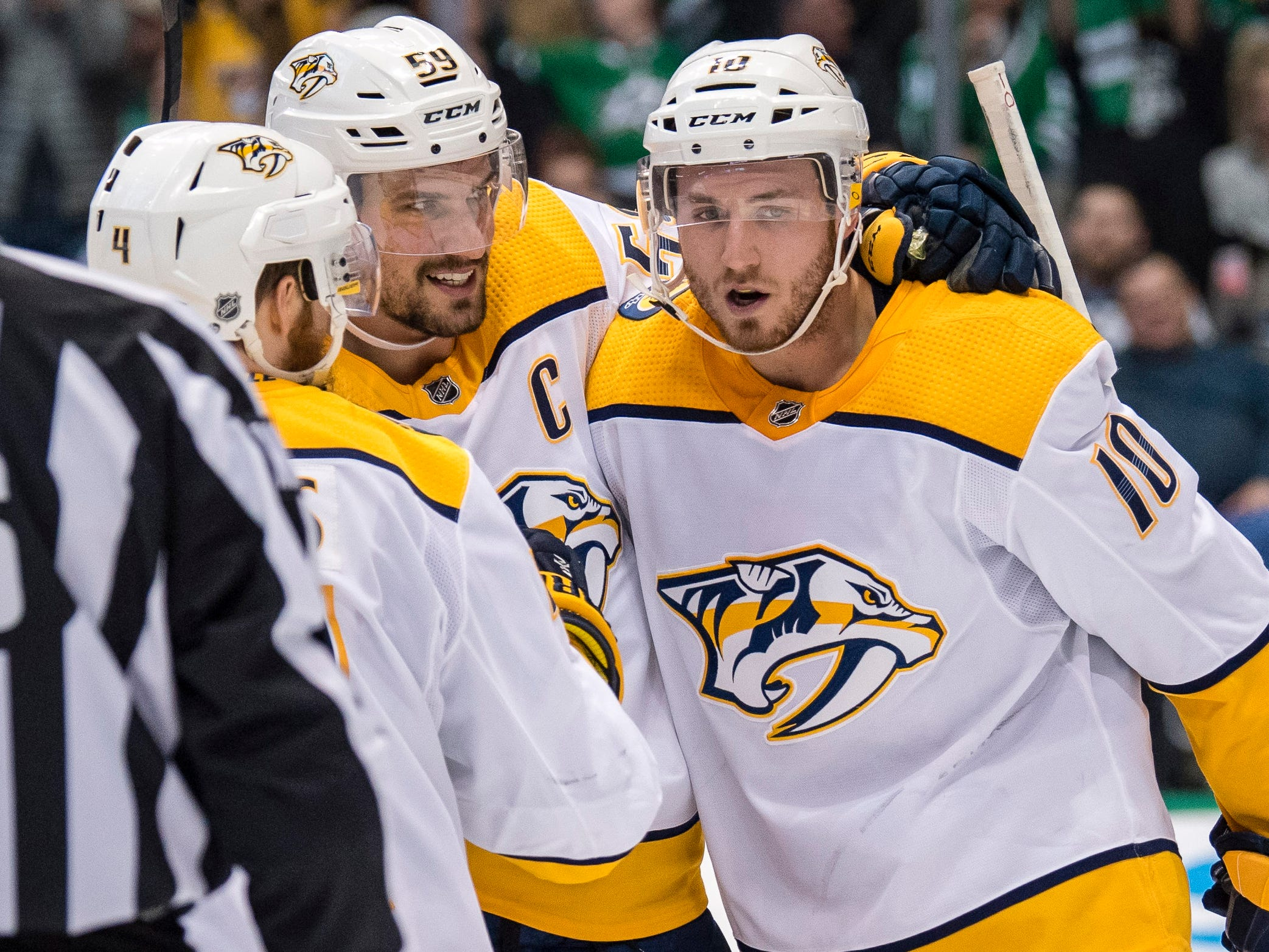 Feb. 19, 2019: Predators 5, Stars 3 -- Predators defenseman Ryan Ellis (4) and defenseman Roman Josi (59) and center Colton Sissons (10) celebrate the game winning goal by Josi during the third period against the Dallas Stars at the American Airlines Center.