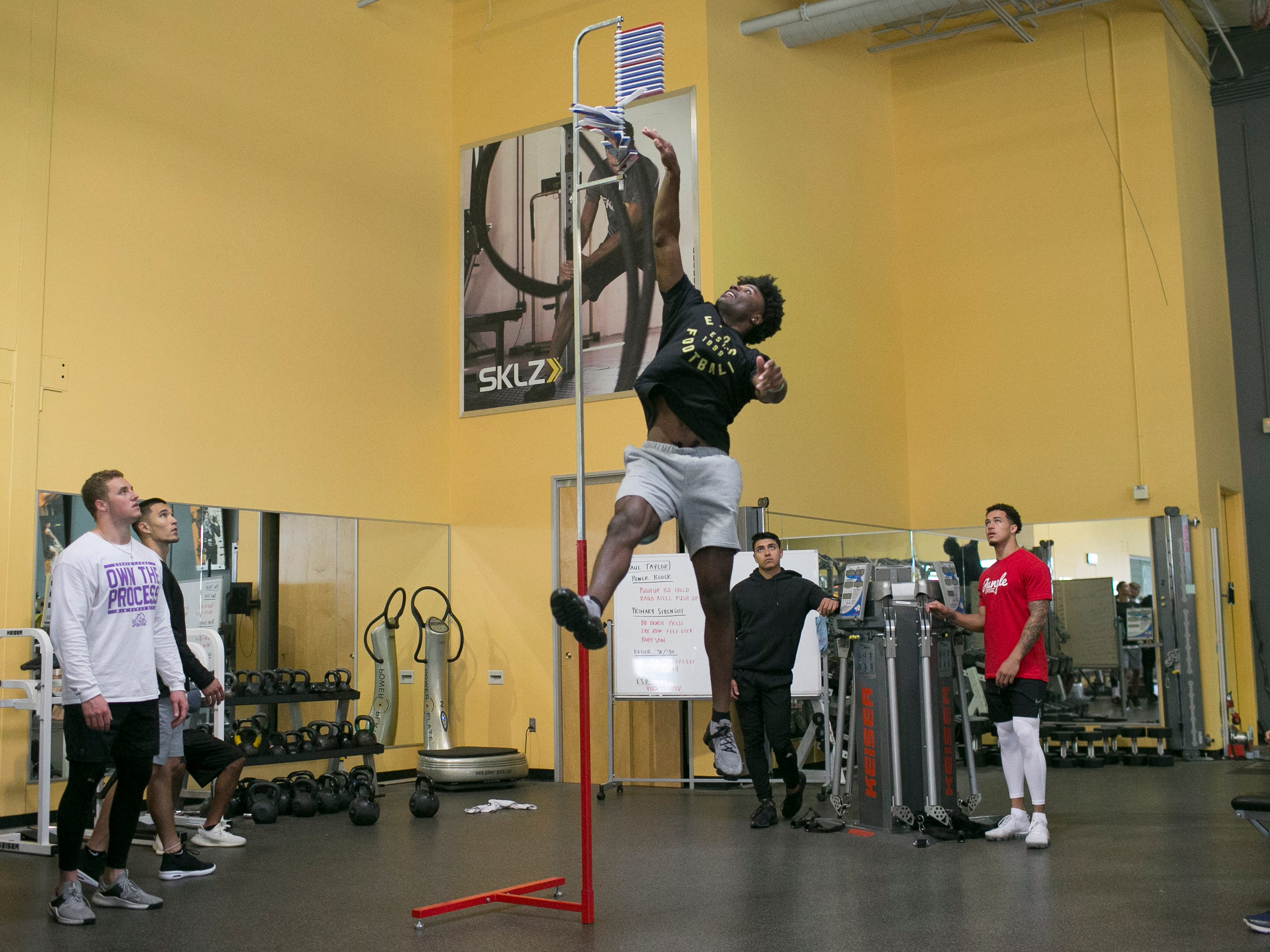 Joejuan Williams (center), a former defensive back for the Vanderbilt Commodores, prepares for the NFL combine at the EXOS training facility in Phoenix, Ariz., on Monday, February 18, 2019.