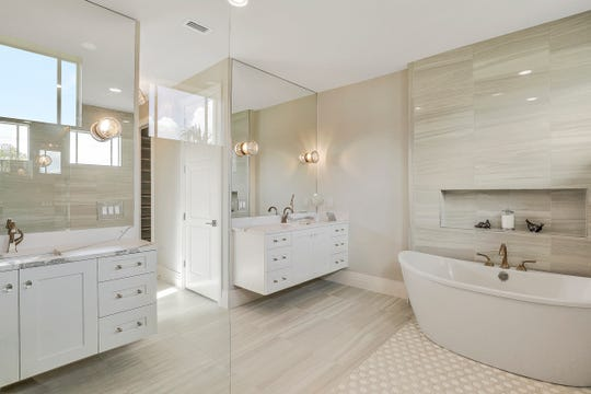 The bathtub in the shower area is an unusual feature.