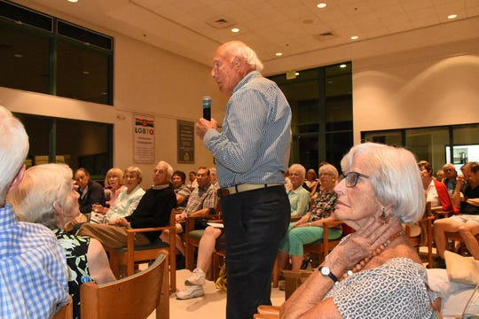 """Dr. Robert Perkins asks a question about the likelihood of legislative action in Florida. The 'Progressive Voices Speak Out' lecture series at the Unitarian Universalist Congregation of Naples hosted Compassion and Choices CEO Kim Callinan for a talk Wednesday evening on """"How Can We Control the End of Our Lives?"""""""