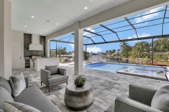 The lanai has a pool, spa, sitting area and outdoor kitchen.