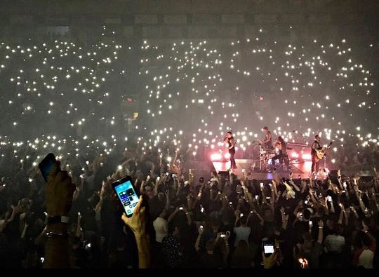 "Fans use their cellphone flashlights at the urging of Shinedown singer Brent Smith for the band's song ""Second Chance"" on Feb. 20, 2019, at Hertz Arena in Estero, Florida."